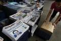 Hong Kong news stand showing a variety of both English and Chinese language dailies. Photo: Reuters