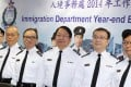 Director of Immigration Eric Chan Kwok-ki (centre) told the media that the Immigration Department aims to recruit 60 assistants this year. Photo: Edward Wong.