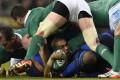Ireland winger Simon Zebo holds on to the ball against France. Photo: AFP