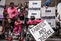 Asylum seekers along with their children stage a protest for their rights in Hong Kong on February 6, 2015, following the recent death of one of them during a fire that broke in a slum. Photo: AFP