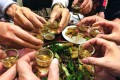 Revellers toast with rice wine at a restaurant in Hanoi. Photo: AFP