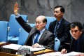 China's UN Security Council envoy votes on Yemen. Photo: Xinhua