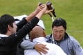 James Hahn (right) is doused in beer by Noh Seung-yul as he gets a hug from Jason Oh after winning the Northern Trust Open. Photo: USA Today