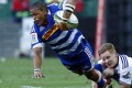 Juan de Jongh of the Stormers is tackled by the Blues' Hamish Northcott during their second-round Super Rugby match in Cape Town on Saturday. The Stormers beat the visitors from New Zealand 27-16. Photos: EPA