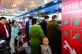 Passengers checking in at Beijing's international airport during the holiday. The numbers travelling to the United States and Australia also increased during the festive period, according to tour agencies. Photo: Xinhua