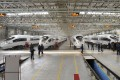 Stated-owned train-makers CNR and CSR were ordered by Beijing to merge to stop excessive competition. Photo: Kyodo
