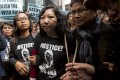 Erwiana Sulistyaningsih, centre, with supporters outside the District Court in Wan Chai yesterday. Photo: Reuters
