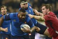 Burly France centre Mathieu Bastareaud brushes off Wales' Gethin Jenkins in their Six Nations match in Paris. Wales won 20-13. Photo: AFP