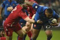 France's Mathieu Bastareaud evades a tackle by Scott Baldwin of Wales. Photo: AFP