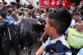 Police pepper spray protesters during yesterday's rally in Yuen Long, the latest in a series of protests aimed at traders from the mainland. Photo: Felix Wong