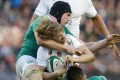 England's Billy Twelvetrees is tackled by Ireland's Tommy O'Donnell. Photo: Reuters