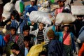 Migrant workers fleeing from the fighting in Kokang last month. China is concerned about the renewed fighting close to its border. Photo: Reuters