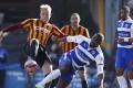 Bradford's Andrew Davies (left) vies with Reading's Yakubu for the ball. Photo: Reuters