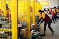 Chinese workers sort out packages meant for online shoppers at a delivery firm. Photo: AFP