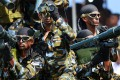 """Sri Lankan army Special Force commando soldiers participate in a Victory Day parade in the southern town of Matara on May 18, 2014. The government is holding a military """"victory parade"""" to mark five years since the defeat of Tamil Tiger rebels, who waged a decades-long battle for a separate homeland for minority Tamils. Photo: AFP"""
