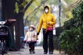 A woman and child wear masks as they walk on a polluted day in Beijing on November last year. Photo: AFP