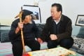 Guo Boquan, right, pictured meeting a member of the public in Xian. Photo: SCMP Pictures