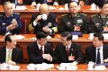 Supreme court president Zhou Qiang (second from right) shakes hands with top prosecutor Cao Jianming yesterday. Photo: Simon Song