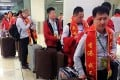 A business delegation from the mainland wear sashes declaring they are not in Hong Kong to shop as they head through Chek Lap Kok airport, according to a post on the Weibo microblog portal. Photo: SCMP Pictures