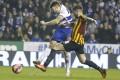 Reading's Jamie Mackie scores past Bradford's Alan Sheehan. Photo: AP