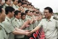Disgraced former general Xu Caihou, whose death was reported on Sunday, is pictured in 2004 greeting members of  China's PLA in Jilin province. Photo: AP