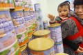 The so-called milk ban restricts outbound travellers to two tins of infant formula. It was imposed by the government in March 2013 amid shortages of certain brands. Photo: David Wong