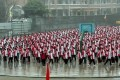 Students at a middle school in Yulin, China, are forced to work out in the rain. Photo: SCMP Pictures
