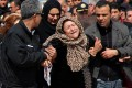 The mother of the Tunisian policeman shot dead in the Bardo Museum attack becomes emotional during a tribute to her son. Photo: AFP