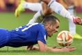 Everton's Leon Osman takes a tumble against  Dynamo Kiev. Photo: AFP
