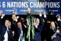 Ireland captain Paul O'Connell lifts the Six Nations trophy after a tumultuous final day. Photos: AFP