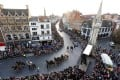 Tens of thousands of people line the streets of Leicester to see the coffin of England's Richard III taken in procession to his final burial, five centuries after his battlefield death. Photo: Reuters