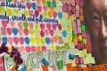 Tributes postered on the board outside the Singapore General Hospital where Lee Kuan Yew remains critically ill in the Intensive Care Unit. Photo: AFP