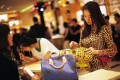 A woman shops in a Louis Vuitton store during Vogue's 4th Fashion's Night Out: Shopping Night with Celebrities in downtown Shanghai. Photo: Reuters