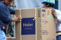 Haier's Goodaymart will help franchises go online, reduce inventory and become online-to-offline channels for e-commerce services providers and merchants. Photo: Bloomberg