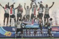 The bubbly flows as the outstanding Fiji squad celebrate their victory over New Zealand in the Cup final at the Hong Kong Sevens. Photo: Sam Tsang/SCMP