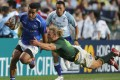 Samoa's Samoa Toloa slips a committed Werner Kok tackle during Sunday's Hong Kong Sevens third-place play-off match won by South Africa. Photos: KY Cheng/SCMP