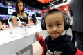 An attendee tries out a pair of headphones at the Consumer Electronics Show in Las Vegas, Nevada. The show will come to Shanghai for the first time this year. Photo: AFP