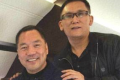 An undated photo posted on a microblog on Monday shows Beijing Zenith's Guo Wengui (left) and Founder Group's Li You on a private jet. Photo: SCMP Pictures