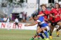 Hugo Stiles gets the ball away under pressure for the Hong Kong U20 fifteens. This weekend in Tokyo, the junior standout will get his first senior sevens cap for Hong Kong at the Japan Sevens. Photo: HKRFU