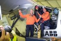 Pilots Andre Borschberg and Bertrand Piccard celebrate after the Solar Impulse 2 lands at Chongqing. Photo: Xinhua