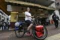 Julia Mason cycles through Kennedy Town, Hong Kong. Photo: Jonathan Wong