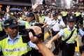 Police officers clear the occupied area in Mong Kok last year. An EOC survey last September found almost one in five employees had experienced discrimination in the workplace. Photo: EPA