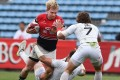 Hong Kong skipper Jamie Hood carries the ball into battle against England in their Japan Sevens pool clash at the weekend. Photos: AFP