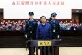 Former Nanjing mayor Ji Jianye stands trial at the Yantai Intermediate People's Court. Photo: Xinhua