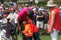 Tiger Woods with his kids and girlfriend at Augusta. Photo: Reuters