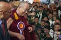 The Dalai Lama is welcomed by schoolchildren upon his arrival at the Tibetan Institute of Performing Arts in Dharmsala, India. Photo: AP