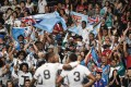 Fans at the 40th edition of the Hong Kong Sevens salute Fiji following their 33-19 Cup final triumph over New Zealand. Photo: AFP
