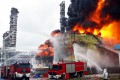 Firefighters battle a blaze following an explosion at a plant producing paraxylene in Zhangzhou, Fujian. Photo: AFP