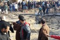 Egyptians gather around the crater formed when a bomb struck the police station in el-Arish, northern Sinai province, killing eight.Photo: AP