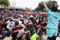 Residents occupy a street in downtown Heyuan on Sunday, demanding the government scrap an 8 billion-yuan coal plant. Photo: SCMP Pictures